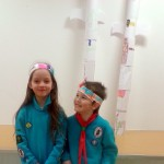 Showing off their totem poles.